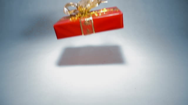 Christmas gift dropping and bouncing in slow motion