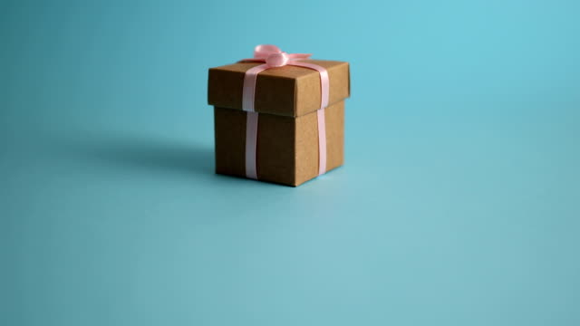 christmas gift panning with blue background - wrapping paper stock videos & royalty-free footage