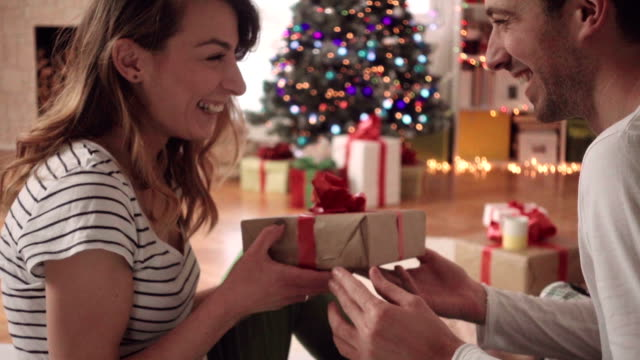 christmas gifts exchange - christmas gift stock videos & royalty-free footage