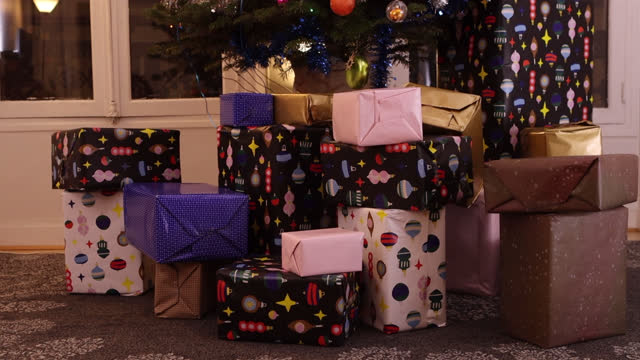 christmas gifts in front of the christmas tree - pinaceae stock videos & royalty-free footage