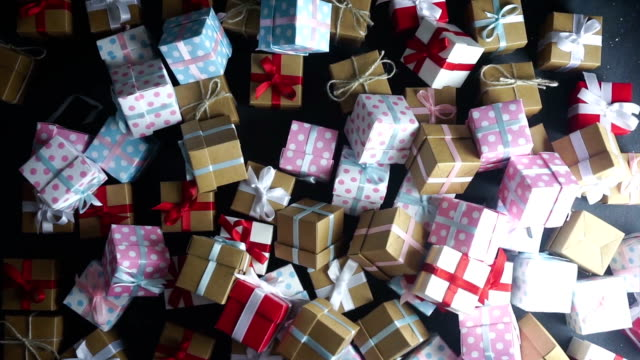 christmas gifts on black table in a row - stack stock videos & royalty-free footage