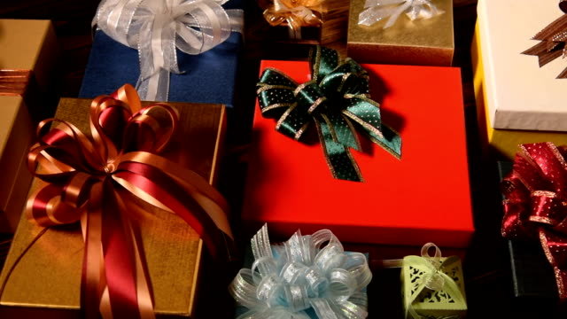 christmas gifts on wooden background - christmas present stock videos and b-roll footage