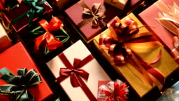 Christmas gifts on wooden background with christmas light