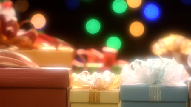 Christmas gifts with defocused spot lights on the background with soft filter