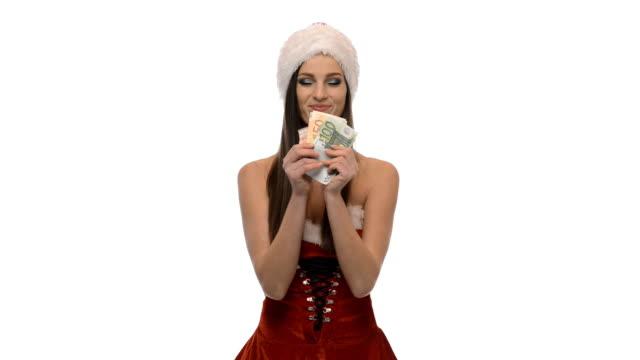vídeos y material grabado en eventos de stock de chica de navidad con dinero - mamá noel