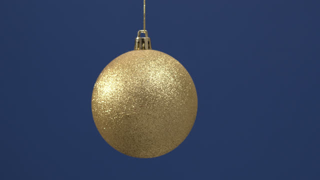 christmas glittering decoration for the new year tree hanging on a blue background. - design element stock videos & royalty-free footage
