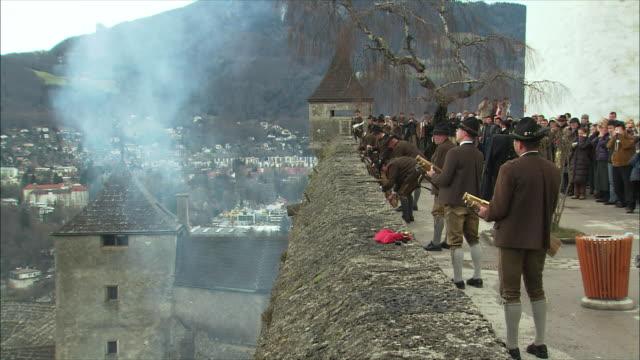 ws christmas gun salute at hohensalzburg fortress / salzburg, austria - austrian costume stock videos and b-roll footage