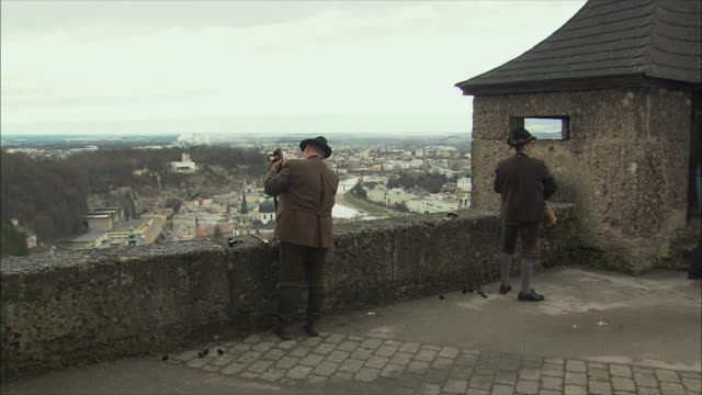 ws pan christmas gun salute at hohensalzburg fortress / salzburg, austria - austrian costume stock videos and b-roll footage