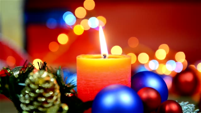 christmas holiday decoration with candle, baubles and flashing lights - christmas decore candle stock videos & royalty-free footage