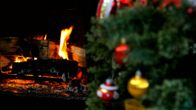 christmas holiday decorations near fireplace - warming up stock videos & royalty-free footage
