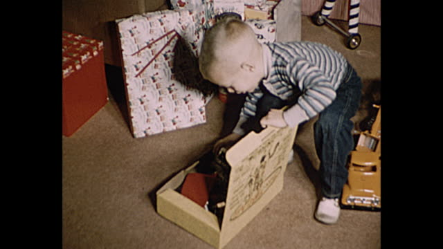 1957 christmas home movie - christmas gift stock videos & royalty-free footage