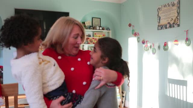 christmas hugs with grandma - visit stock videos & royalty-free footage