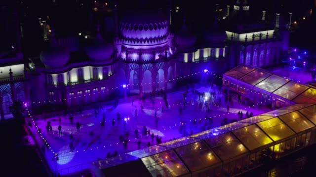 christmas ice skating at brighton royal pavilion as seen by drone - ice skating stock videos & royalty-free footage