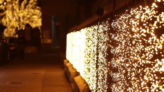 christmas illumination avenue montaigne. paris - pavement stock videos & royalty-free footage