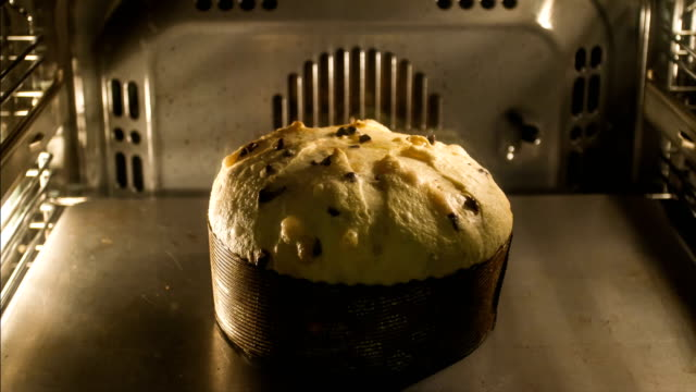 christmas in italy - timelapse of panettone in the oven - bread stock videos & royalty-free footage