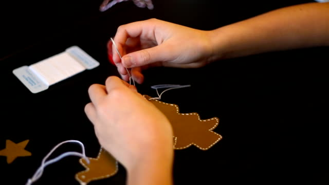 christmas in spain. little girl doing crafts to decorate her house on christmas. - parte de una serie video stock e b–roll