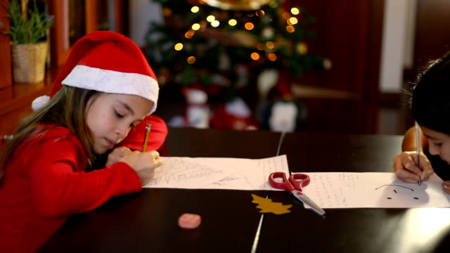 vídeos y material grabado en eventos de stock de christmas in spain. siblings drawing and writing the letter to santa claus (or the three wise men) in a cozy home. - reyes magos