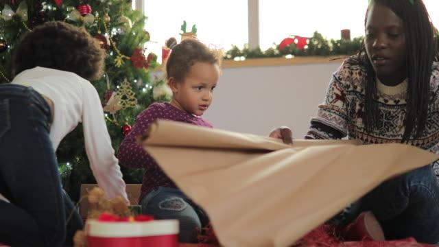 christmas is near - girl sitting cross legged stock videos & royalty-free footage
