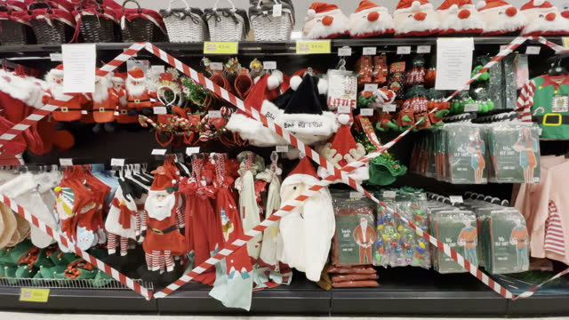 christmas items with tape across them in a cardiff bay home bargains store on october 27 in cardiff, wales. pressure has mounted on the welsh... - christmas stock videos & royalty-free footage