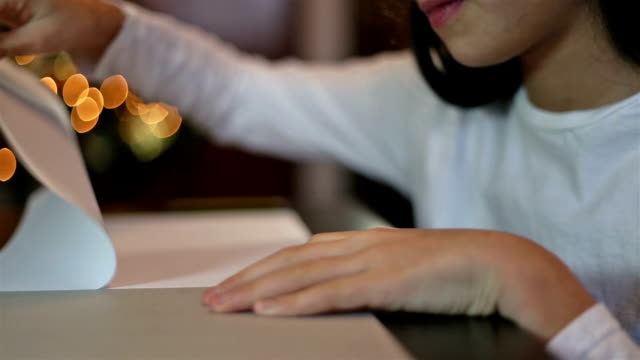 christmas letter. girl taking off a page. - parte de una serie video stock e b–roll