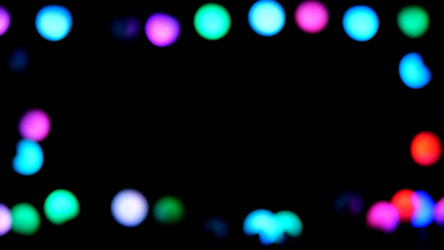 vídeos de stock e filmes b-roll de christmas light frame.light frame black background - cordel