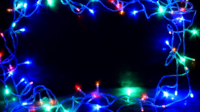 christmas light on black background 4k - border stock videos & royalty-free footage