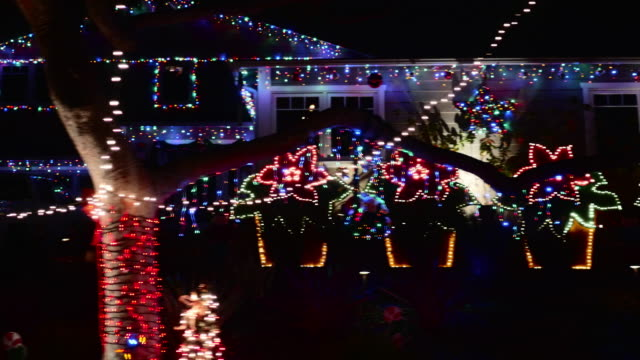SIDE POV Christmas Lights Decorate Suburban Homes