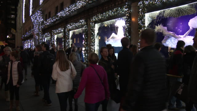 christmas lights & holiday window display - saks 5th avenue - window display stock videos and b-roll footage