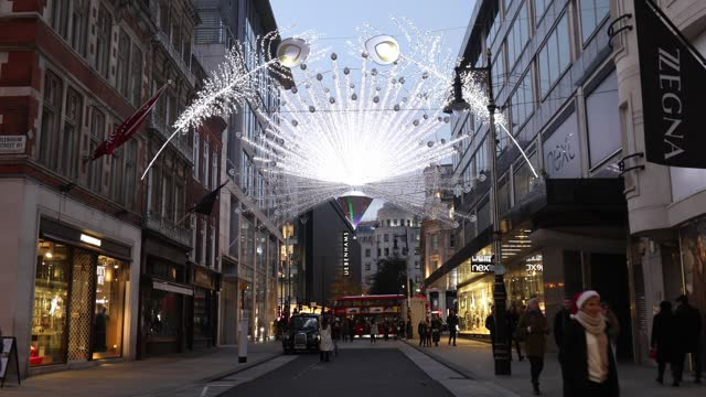 christmas lights illuminate new bond street during the second major lockdown of the coronavirus pandemic on november 24, 2020 in london, england. - small group of people stock videos & royalty-free footage