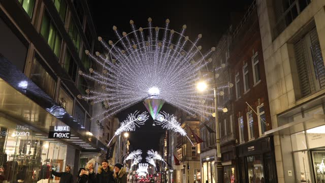 christmas lights illuminate new bond street during the second major lockdown of the coronavirus pandemic on november 24, 2020 in london, england. - street light stock videos & royalty-free footage