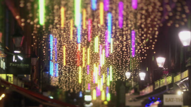 MS SELECTIVE FOCUS Christmas lights on street at night / Westminster, London, United Kingdom