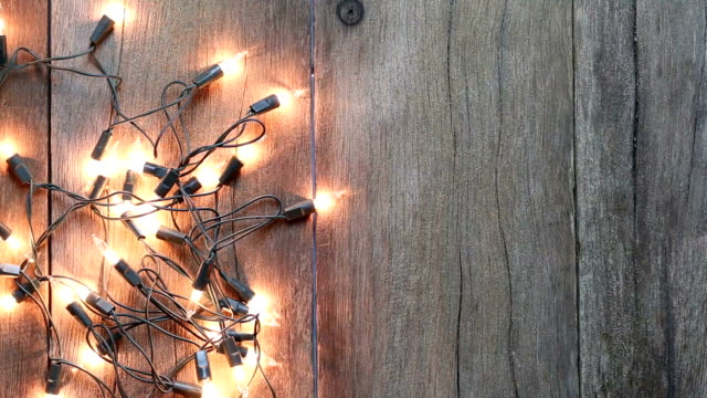 christmas lights on wooden floors. - ornate stock videos & royalty-free footage