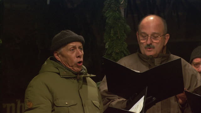 ms christmas market (christkindlesmarkt) choir members singing / nuremberg, bavaria, germany - choir stock videos & royalty-free footage