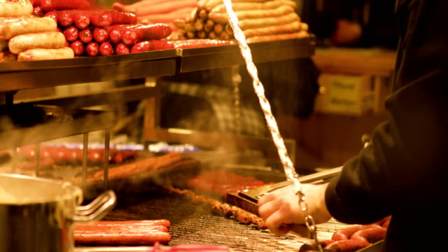 christmas market sausage grill - sausage stock videos & royalty-free footage