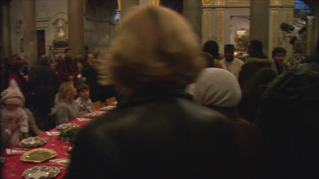 MS PAN Christmas meal for less fortunate in Basilica di Santa Maria in Trastevere / Rome, Italy