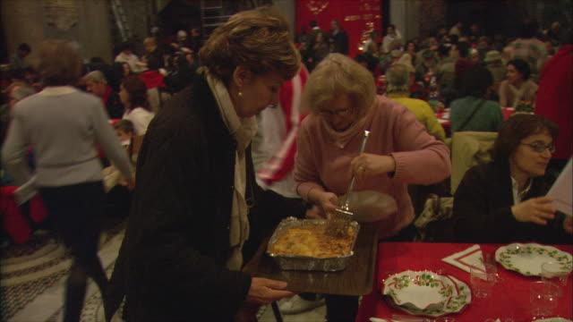 MS Christmas meal for less fortunate in Basilica di Santa Maria in Trastevere / Rome, Italy