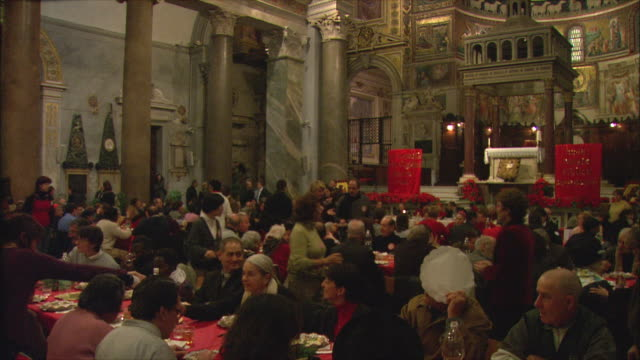 WS PAN Christmas meal for less fortunate in Basilica di Santa Maria in Trastevere / Rome, Italy