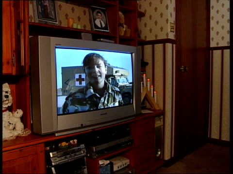 christmas message to iraq lunchtime news martin geissler carnoustie bob matthew and cathy matthew sitting looking at photograph iraq basra ext/dusk... - basra stock videos and b-roll footage