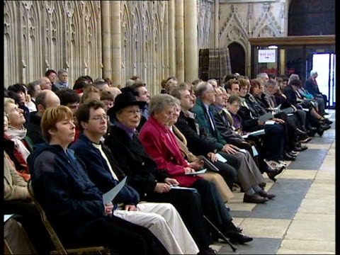 Iraq ITN ENGLAND Yorkshire York Dr David Hope into York Minster INT Hope into church Minster TILT DOWN congregation Hope in pulpit Dr David Hope...