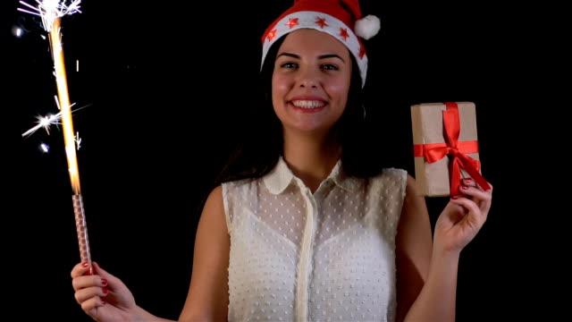 christmas model woman wearing santa hat - santa hat stock videos & royalty-free footage