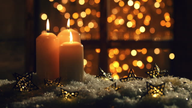 christmas or new year composition with burning candles - burning stock videos & royalty-free footage