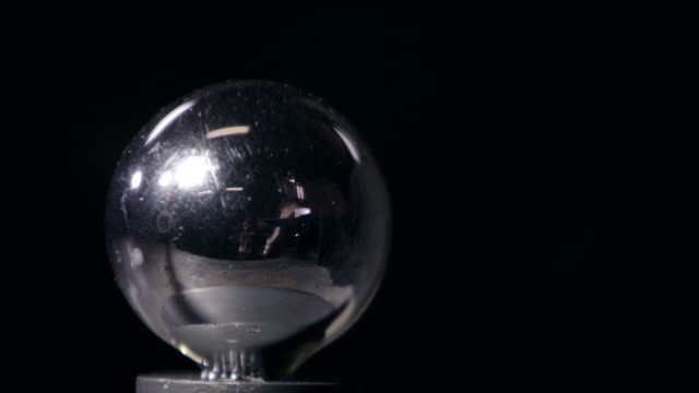 christmas ornament being shot with steel ball and breaking - aufprall stock-videos und b-roll-filmmaterial