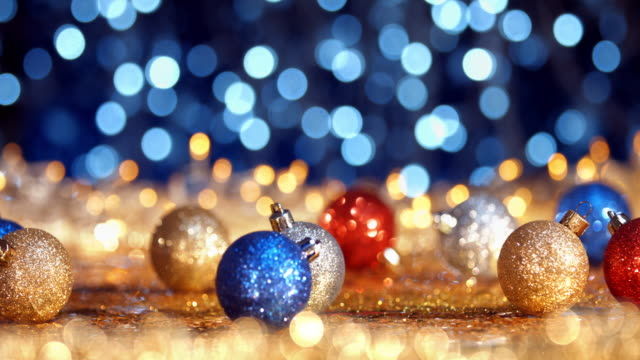 Christmas ornament on defocused lights. Decorations Bokeh Blue Gold