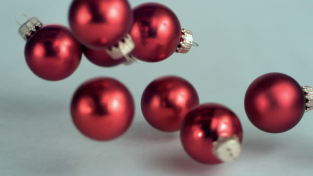 vídeos de stock, filmes e b-roll de slo mo cu christmas ornaments falling, new york state, usa - ornament