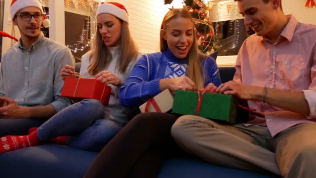 christmas party -  generation z celebrating christmas and opening christmas gifts - decoration stock videos & royalty-free footage