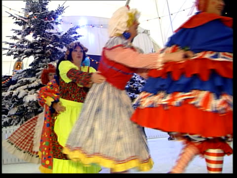 christmas plans; itn england: london: greenwich: millennium dome: int millennium dome chief executive pierre-yves gerbeau posing with actors dressed... - fake snow stock videos & royalty-free footage