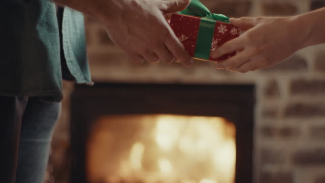 christmas present! - exchanging stock videos & royalty-free footage