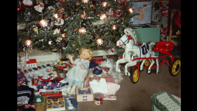 1958 home movie christmas presents under tree including trolley horse, dolls and howdy doody puppet theater / toronto, canada - stockings stock videos & royalty-free footage