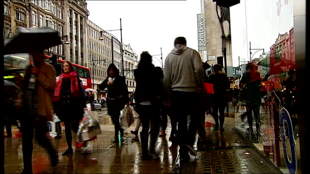 retailers hoping for bumper day on last saturday before christmas; london: oxford street: ext shoppers along street legs of shoppers along - bumper stock videos & royalty-free footage