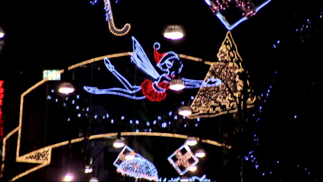 Robbie Williams turns on Christmas lights in Oxford Street More of lights